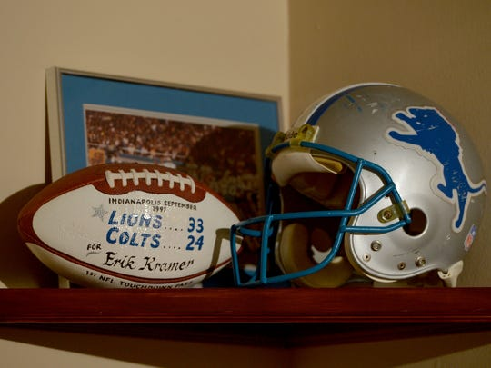 Erik Kramer, a former National Football League quarterback, has a few pieces of memorabilia in his Agoura Hills home. Among the pieces are a football marking his first NFL touchdown pass when he was with the Detroit Lions in September of 1991 and his helmet.