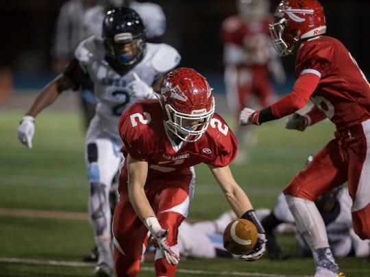 Keyport's Cody Young loses but then scoops up the ball as he heads down the sideline for a second-half Keyport touchdown.