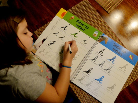 Caylee Brammer has been working on cursive handwriting since the first grade.