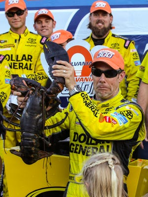 Matt Kenseth holds a lobster in Victory Lane after winning the NASCAR Sprint Cup series auto race at New Hampshire Motor Speedway in Loudon, N.H. on Sunday.