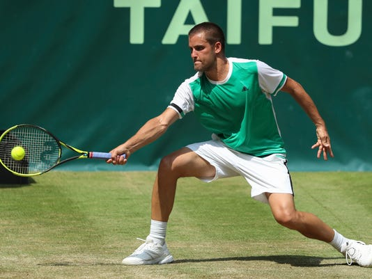 Russia'  Mikhail Youzhny returns a shot to Russia's Andrey Rublev  at the Gerry Weber Open tennis tournament, in Halle, Germany, Thursday, June 22, 2017.  (Friso Gentsch/dpa via AP)
