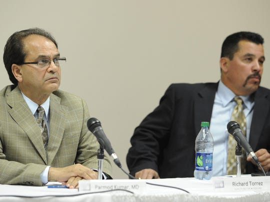 Former Vice Chairman Parmod Kumar and former Treasurer Richard Torrez during the Tulare Regional Medical Center board of directors special meeting.