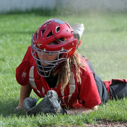 Milford Catcher Kelsey Seitz makes a diving catch of