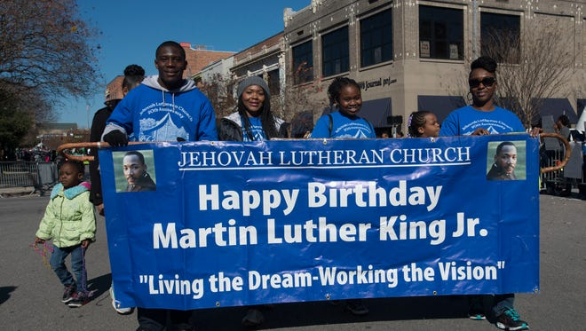 Organizations from around community come together to honor the memory of Martin Luther King, Jr. with a parade though the streets of downtown Pensacola Monday morning Jan. 18, 2016.