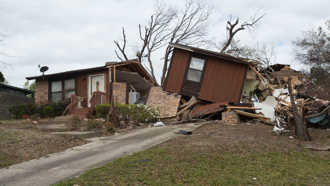 One month after a tornado struck the Harbor Square subdivision in Pensacola much of the debris has been removed by many of the homes are still in various states of disrepair.