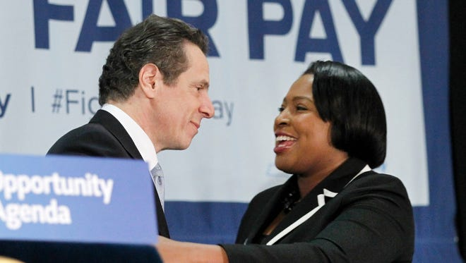 Gov. Andrew Cuomo embraces Rochester Mayor Lovely Warren after delivering a speech during the Fight for Fair Pay Campaign Rally at the Workers United Rochester Regional Joint Board on East Avenue Wednesday morning.