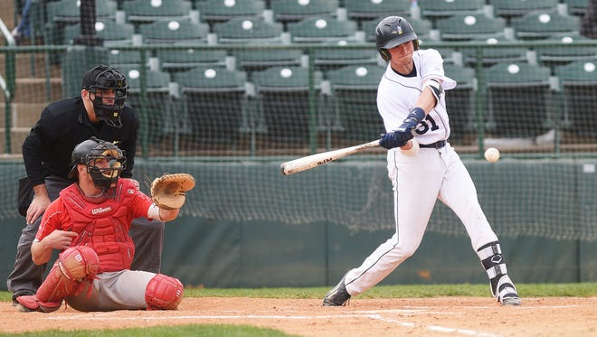 Augustana's Jordan Barth hits a home run during the game against St. Cloud State in the NSIC baseball playoffs Thursday, May 10, at Sioux Falls Stadium.