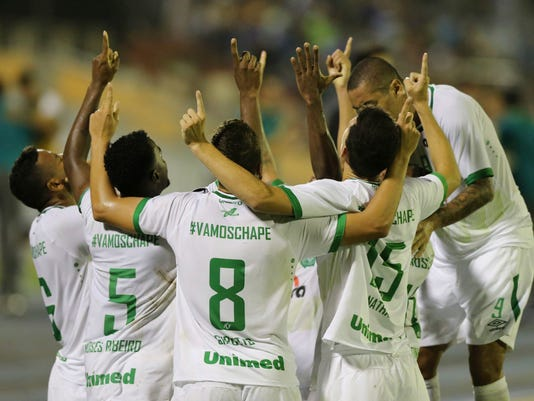 FILE - In this March 7, 2017 file photo, Brazil's Chapecoense players celebrate after their teammate Reinaldo, left, scored against Venezuela's Zulia FC at a Copa Libertadores soccer match in Maracaibo, Venezuela. It will be anything but a typical soccer cup final when Chapecoense faces Atletico Nacional in the first leg of the Recopa Sudamericana on Tuesday April 6, 2017. (AP Photo/Fernando Llano, file)