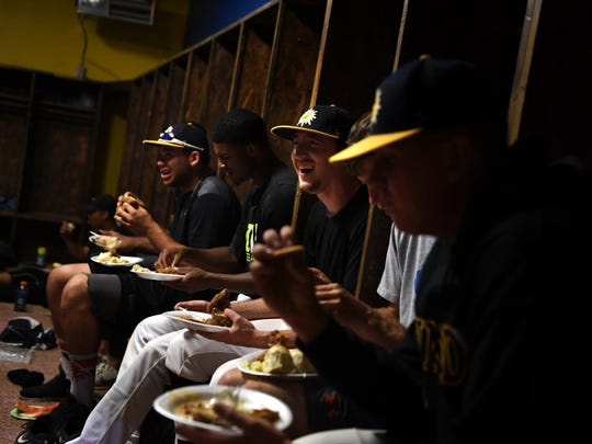 Trinidad Triggers in the club house eating a special dinner from the host families after their win over the White Sands Pupfish on their first home game after a long road trip.  June 22, 2017 in Trinidad, CO.