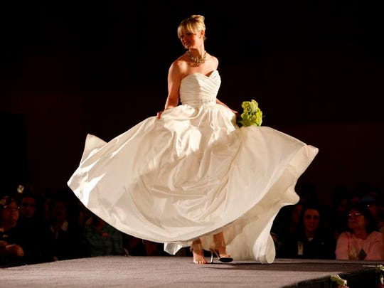 Models strutted their stuff showing off gowns in a fashion show during The 30th Annual Wendy's Bridal Show at the Duke Energy Center Saturday January 2, 2010.