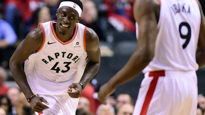 Toronto Raptors forward Pascal Siakam (43) smiles as he celebrates a dunk against the Orlando Magic during the second half in Game 5 of a first-round NBA basketball playoff series, Tuesday, April 23, 2019 in Toronto. (Frank Gunn/Canadian Press via AP)
