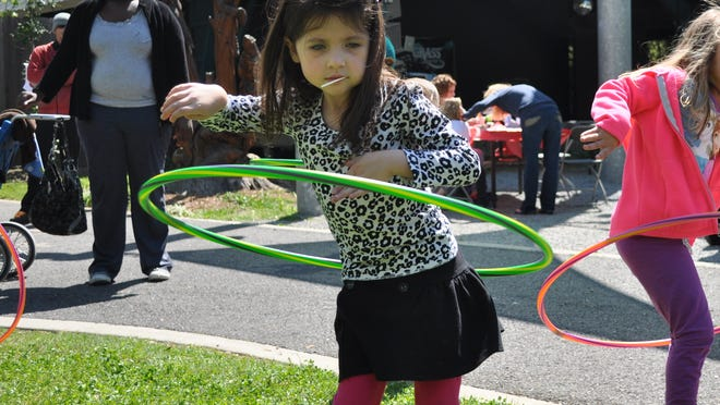 """Kaytelyn Evans uses a hula hoop at the Alexandria Zoo's """"Just for the Health of It Day Camp."""" Activities and demonstrations aimed at preventing obesity encouraged kids to be active and eat right to stay healthy."""
