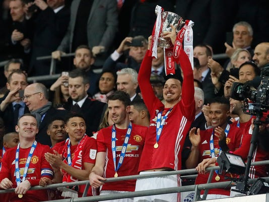 United's Zlatan Ibrahimovic lifted the trophy after they won the English League Cup final soccer match between Manchester United and Southampton FC at Wembley stadium in London, Sunday, Feb. 26, 2017. (AP Photo/Kirsty Wigglesworth)