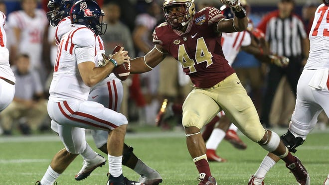FSU's DeMarcus Walker charges in to sack Ole Miss quarterback Chad Kelly in the season-opener in September.