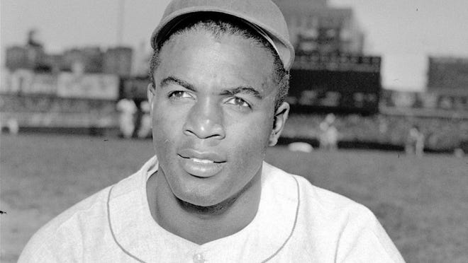 Brooklyn Dodgers player Jackie Robinson poses in 1948.