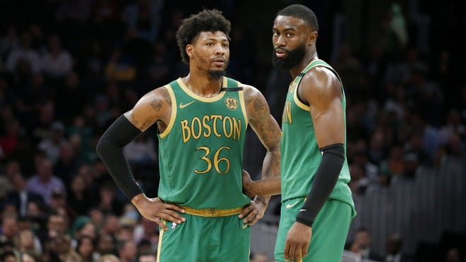 Boston's Marcus Smart, left, and Jaylen Brown are the only Celtics to have played in the past three Eastern Conference finals for the team.