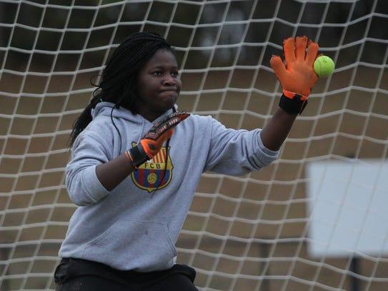Sydney Robinson and the Florida High girls soccer team