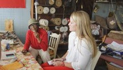 University of Mississippi student Mollie Mansfield, right, interviews civil rights activist and business owner Vernice Sanders, center, with Professor Bill Rose at Vernice's Upholstery in Leland, Miss. on March 11, 2014.