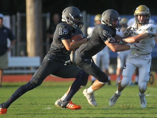 Maclay's Matt Boynton heads upfield after making a