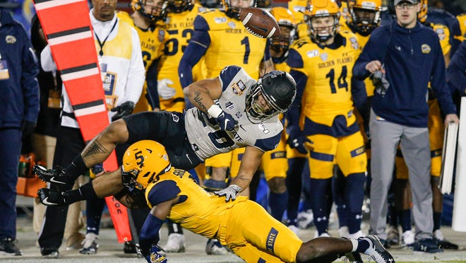 Kent State safety Keith Sherald Jr. forces a fumble during the 2019 Frisco Bowl victory over Utah State in Frisco, Tex. Sherald will miss all of the 2020 season after suffering an Achilles injury during preseason camp.