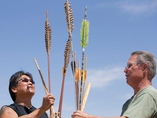 Charlie Tadano, left, and Bob Sizemore  sort through atlatl darts. Pat Shannahan/The Arizona Republic