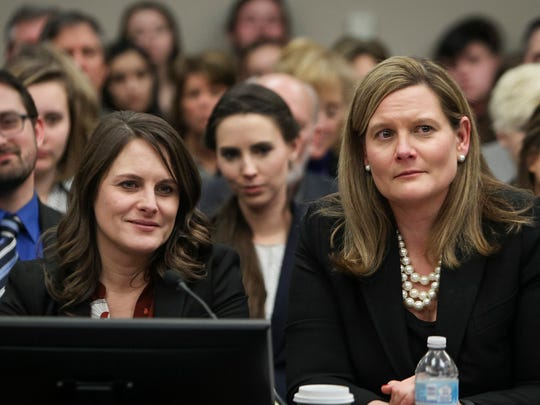 MSU Police Det. Lt. Andrea Munford, left, and Assistant Attorney General Angela Povilaitis react to a comment from Judge Rosemarie Aquilina near the end of Larry Nassar's sentencing hearing in Ingham County Circuit Court on Wednesday, Jan. 24, 2018. Behind them (from left) are Jacob Denhollander, Rachael Denhollander and Kyle Stephens.
