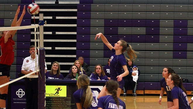 Ravenswood's Victoria Cerino goes up to reject the spike of Portland's Alexia Doris during Thursday's Class AAA sectional match.