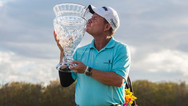 Joe Durant kisses his trophy on the final day of the Chubb Classic in Naples on Sunday.  Olivia Vanni/Naples Daily News Chubb Classic champion Joe Durant kisses his trophy on the final day of the Chubb Classic in Naples on Sunday, Feb. 18, 2018.