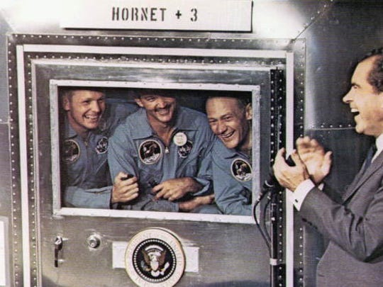 : President Richard M. Nixon greets astronauts Neil Armstrong, Michael Collins, and Edwin Aldrin upon their return from the moon, on July 24, 1969.