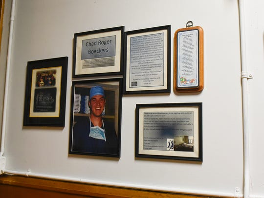 Plaques fill a wall in the men's wing Tuesday, Oct.