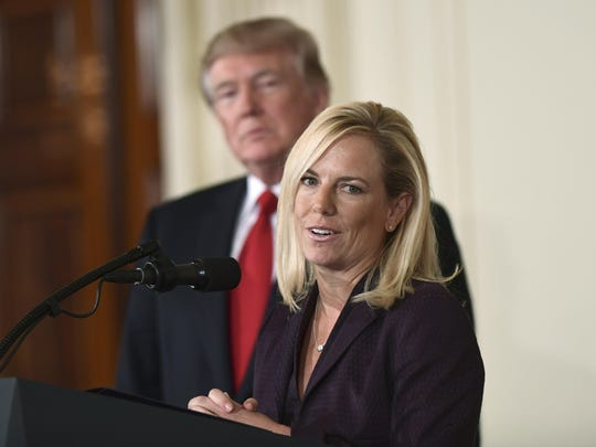 President Donald Trump, left, listens as Kirstjen Nielsen, right, a cybersecurity expert and deputy White House chief of staff, speaks in the East Room of the White House in Washington after Trump announced that she is his choice to be the next Homeland Security Secretary.
