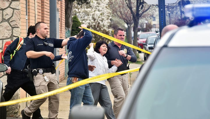 An unidentified woman is taken to the ambulance after