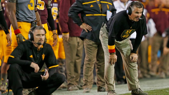 ASU coach Todd Graham (right) and offensive coordinator Mike Norvell watch the Sun Devil offense against Oregon at Sun Devil Stadium in Tempe on October 29, 2015.