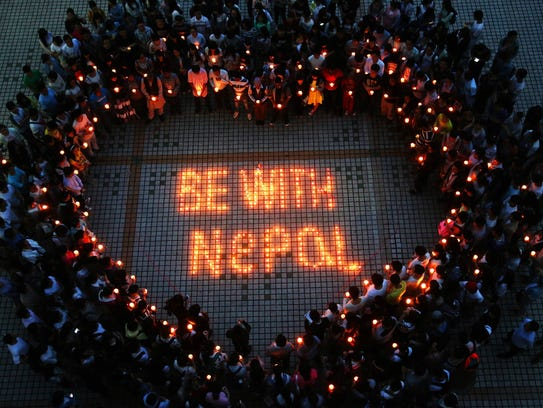 Nepalese students and Chinese students gather to pray