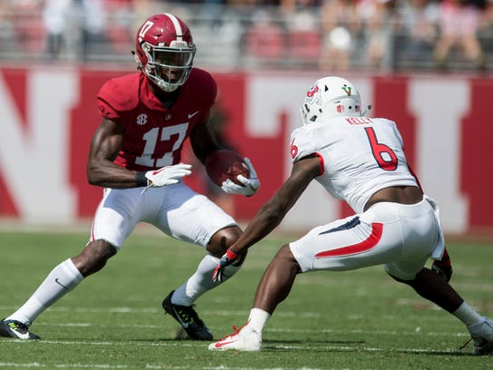 Alabama wide receiver Cam Sims (17) is defended by