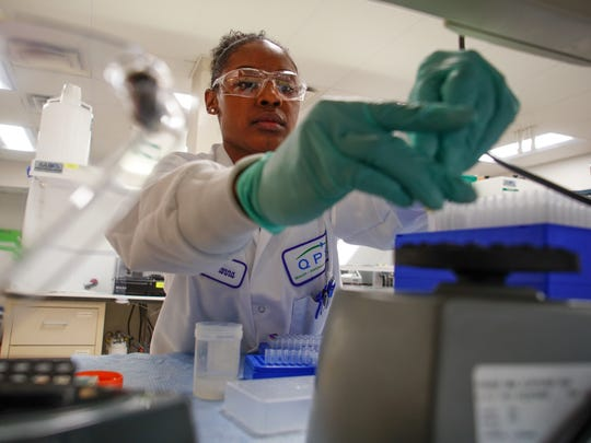 Andreanna Jefferies, an associate scientist for QPS Holdings, works in a lab at the Delaware Technology Park where she tests human blood samples for concentrations of a new drug now undergoing clinical trials.