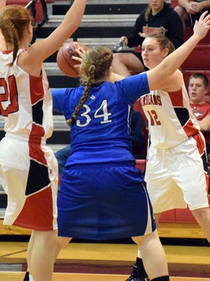 Riverheads' Emma Casto, right, looks for a teammate to pass to as Fort Defiance's Julia Frazier gets between Casto and the Gladiators' Blake Bartley during their girls basketball game Wednesday, Dec. 14, 2016, at Riverheads High School in Greenville, Va.