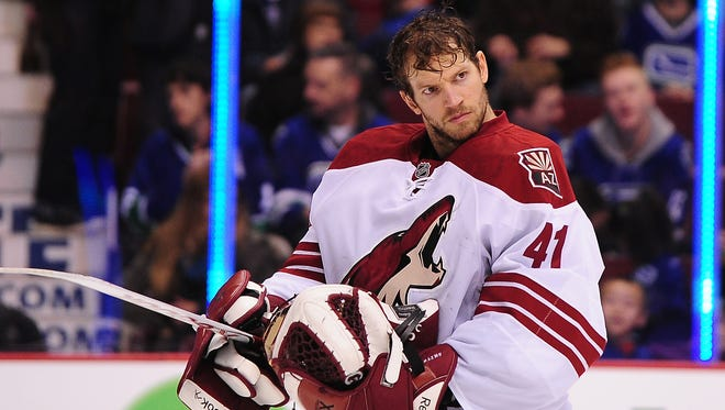 Arizona Coyotes goaltender Mike Smith (41) enters the ice for the start of the first period against the Vancouver Canucks.