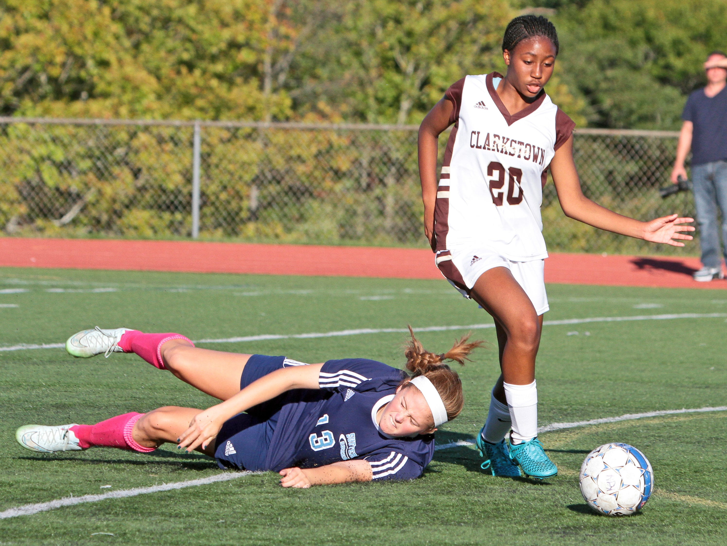 Clarkstown South's Sophia Jean-Charles leaves Suffern's Caleigh Cahoon behind during a varsity soccer game at Clarkstown South High School Oct. 6, 2015. Clarkstown South handed Suffern it's first loss of the season with a 4-1 victory.