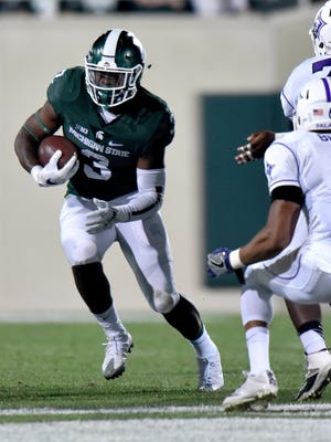 Michigan State running back LJ Scott will need an outstanding game for the Spartans to beat the No. 2 Buckeyes.