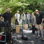 David Holt, Will and Deni McIntyre, Josh Goforth and crew members in a production still shot in May. The show is now in production on its second season.