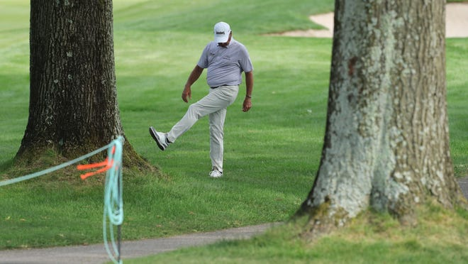 Fred Couples kicks away debris after hitting an errant tee shot on No. 10 during the second round of the Bridgestone Senior Players Championship on Friday at Firestone Country Club.