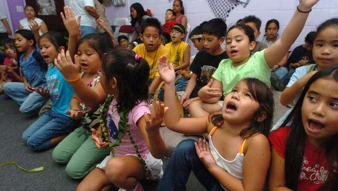 In this July 2005 file photo, children sing during the Hurao Cultural Camp at the Sinajana mayor's office.