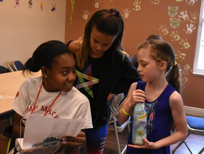 Counselor Naika Desgrottes helps some kids get organized