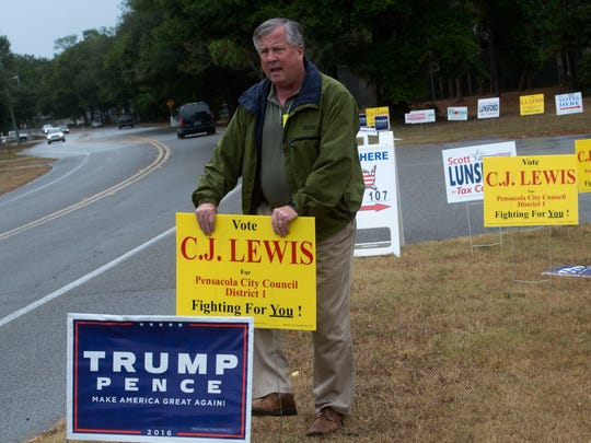 C.J. Lewis tries to drum up a little last minute support for his bid to the Pensacola City Council district 1 seat Tuesday afternoon. Lewis is challenging P.C. Wu for the city council seat.