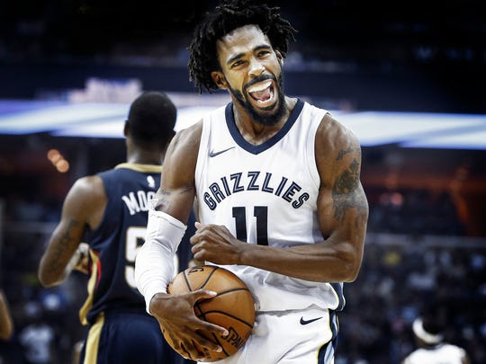 Grizzlies guard Mike Conley celebrates during a Memphis win over the New Orleans Pelicans on Oct. 18, 2017. Conley is recovering from an Achilles injury which held him out for most of last season.