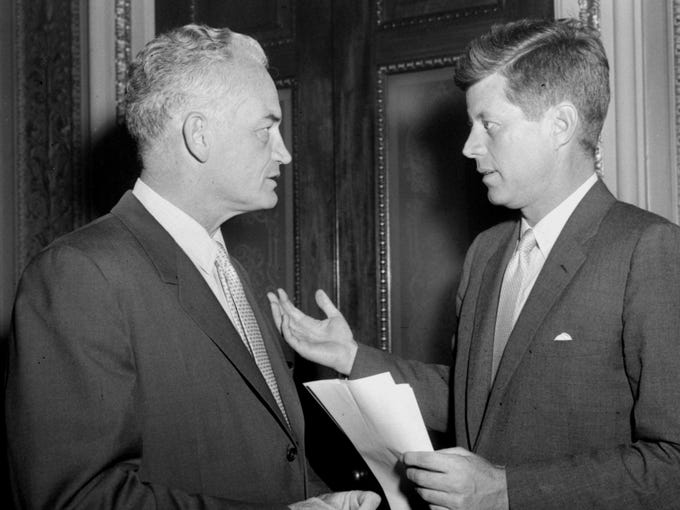 Sen. Barry Goldwater, R-Ariz., left, listens to Sen. John Kennedy D-Mass., on June 13, 1958. Kennedy was  floor manager for the labor-control bill during its consideration by the U.S. Senate.  Goldwater called for plugging more loopholes to tighten union controls.