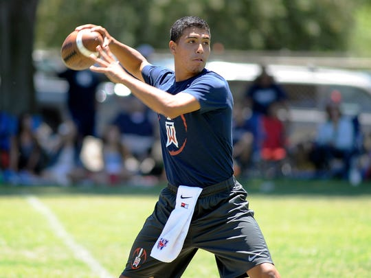 Tulare Western quarterback Kobe Portillo prepares to make a pass against Redwood during Redwood's passing tournament on Friday, June 27, 2014.