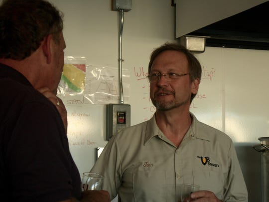 Tom Bullinger of The VB Brewery speaks with a participant at Community Brew Night on Tuesday.
