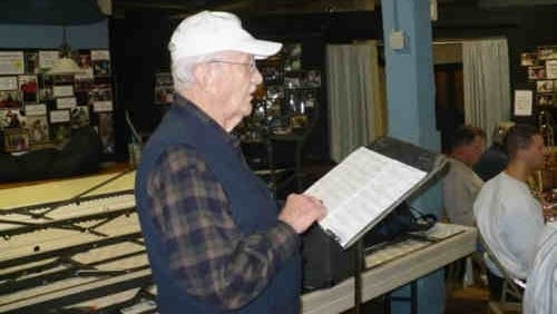 """In this file photo, former York County Commissioner George Trout rehearses with Spring Garden Band for the holiday concert at Dover High School where he will narrate Randol Bass's setting of """"Night Before Christmas."""" (2011 York Dispatch archives)"""